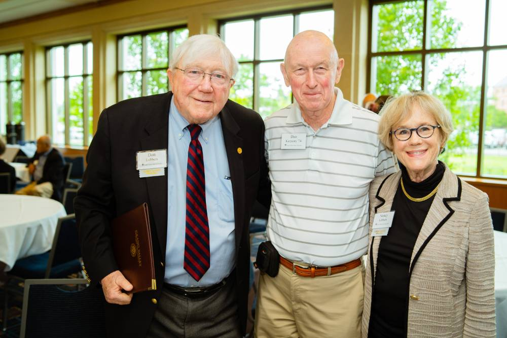 President Emeritus Don and Nancy Lubbers posing with a guest at the Retiree Reception.